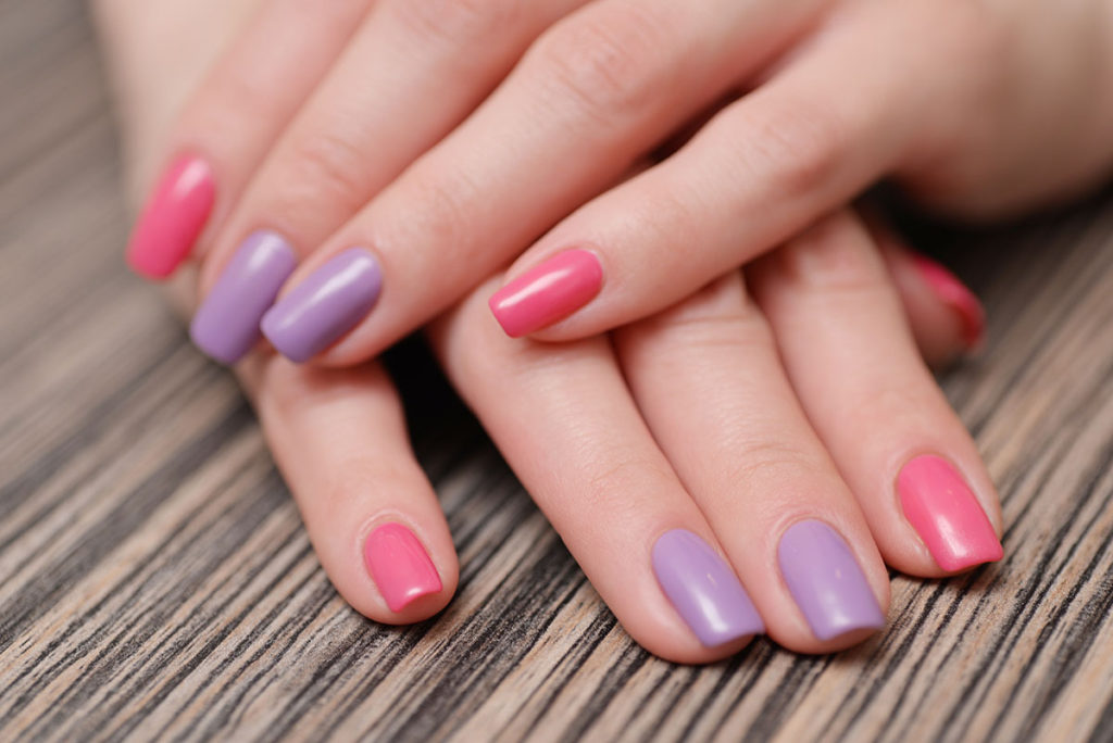 Bright stylish manicure with colored nail polish