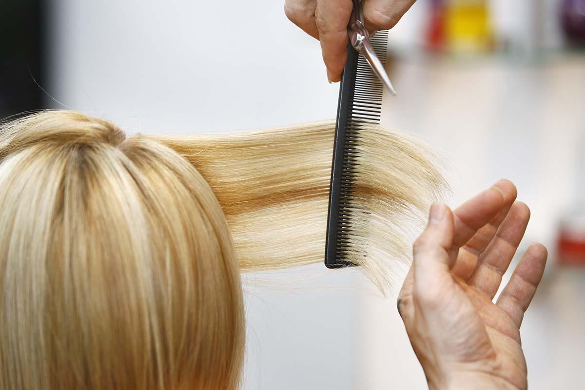 Blue woman in hair salon